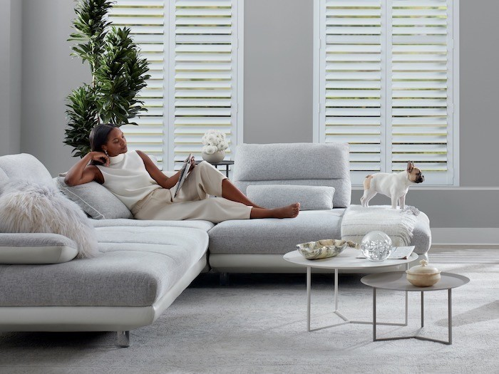 A living room with a set of two coffee tables and interesting objects.