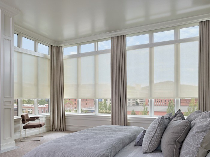 A bedroom with light, airy colors.